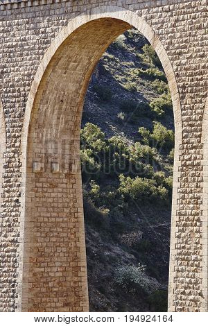 Stone viaduct in Albentosa Teruel. Spain. Green way. Architecture