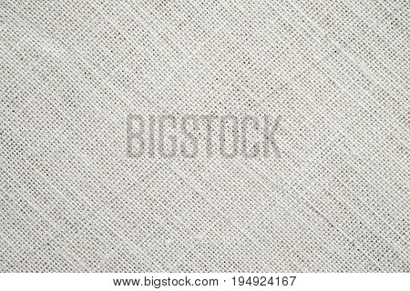 Beige sack cloth texture background detail close up