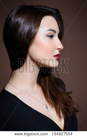 Beauty and makeup concept. Portrait of a beautiful brunette woman with perfect skin and bright makeup. Eyeliner, arrows.