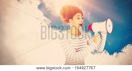 Young woman using megaphone for making announcement  against low angle view of sky