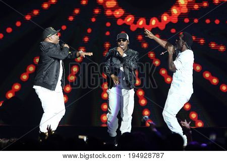 NEW YORK-JUL 7: (L-R) Wanya Morris, Nathan Morris & Shawn Stockman of Boyz II Men perform during The Total Package Tour at the Nassau Veterans Memorial Coliseum on July 7, 2017 in Uniondale, New York.
