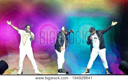NEW YORK-JUL 7: (L-R) Shawn Stockman, Nathan Morris and Wanya Morris of Boyz II Men perform at NYCB Live at the Nassau Veterans Memorial Coliseum on July 7, 2017 in Uniondale, New York.