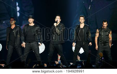 NEW YORK-JUL 7: (L-R) Jonathan Knight, Donnie Wahlberg, Jordan Knight, Joey McIntyre and Danny Wood of New Kids on the Block perform at NYCB Live on July 7, 2017 in Uniondale, New York.