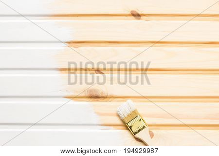 Brush and Painted wooden planks with white paint. Copy space and paste text. mockup