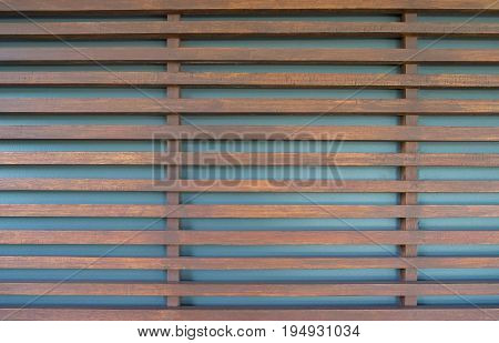 Raw wood wooden slatted fence or lath wall background texture.