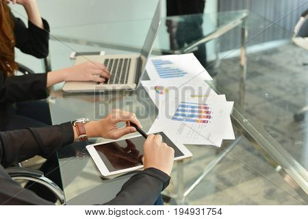 Technology equipment with laptop business documents on meeting table