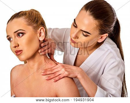 Shoulder and neck massage for woman in spa salon. Doctor making neck therapy in rehabilitation center on isolated. Direction of dislocation in specialized clinic. Severe pain in neck.