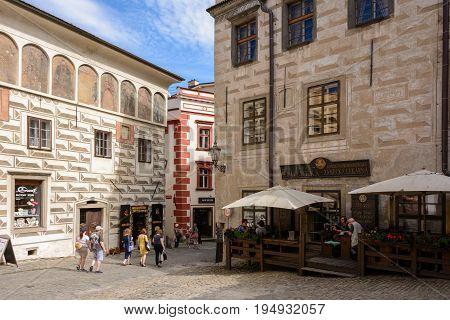 Cesky Krumlov, Czech Republic - June 9, 2017: Tourists on a pedestrian square in Cesky Krumlov