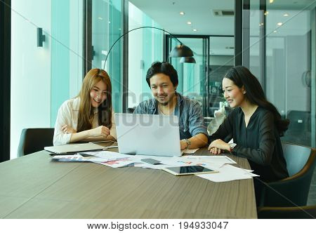 Teamwork Of Asian Business People Working In Meeting Room