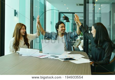 Teamwork Of Asian Business People Giving High Five, Tag Team