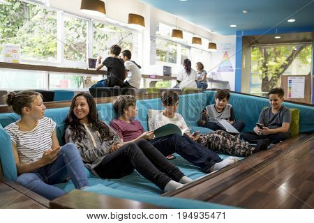 Young adults sitting on sofa couch together