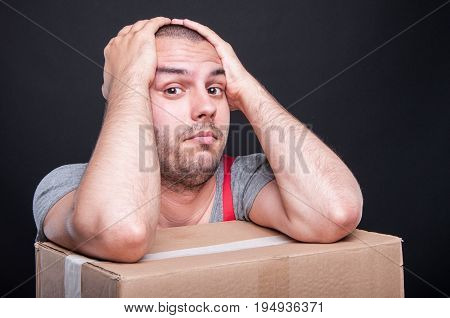 Mover Guy Holding Head Looking In Trouble