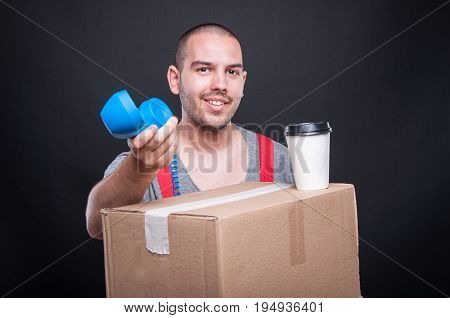 Mover Guy Smiling Offering Telephone Having Coffee