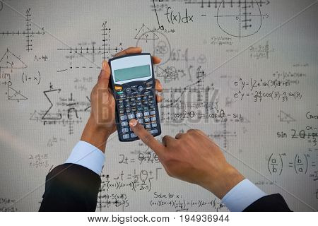 Cropped hands of businessman using calculator  against quadratic equations with solution