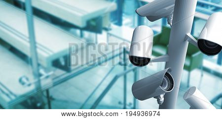 CCTV camera against empty chairs near staircase