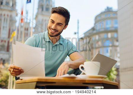Scrupulous worker. Passionate intelligent quick witted guy working as a freelancer and enjoying his day outside the house while spending at public workspace outdoors
