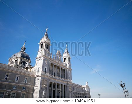 Side view of Cathedral de la Almudena (Santa Maria la Real de la Almudena) in Madrid Spain.