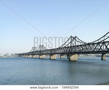 China - North Korea Friendship bridge; across the Yalu river. Taken in April, 2017, from public area in Dandong, Liaoning China, opposite to Sinuiju city, DPRK.