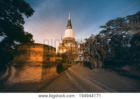 AYUTTHAYA,THAILAND-JULY 9,2017 : Twilight of ruined at Principal Chedi in Wat Yai Chai Mongkhon the Great Monastery of Auspicious Victory is located Ayutthaya Historical Park in Ayutthaya old capital city in Middle of Thailand.