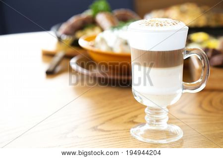 Latte coffee on a wooden table. Latte drink