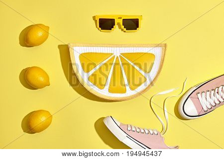 Fashion Summer Hipster Accessories Set. Lemon Citrus fruit, Trendy Sneakers, Clutch, fashion Sunglasses on Yellow. Hot Summer Sunny Vibes. Creative Bright Style. Vanilla Pastel Color. Minimal, Art