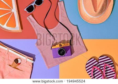 Fashion Film Camera, Retro Design. Summer Clothes Accessories Set. Pop Art Style. Glamor Orange Citrus Clutch, Trendy fashion Sunglasses. Hipster Beach Outfit. Hot summer color.Creative Bright Concept