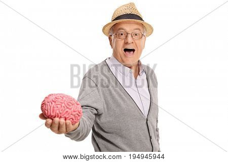 Mature man showing a brain model isolated on white background