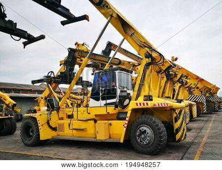Parking Space Area With Yellow Strip Line For Heavy Transportation Equipment Container Handlers