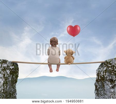 Small baby and teddy bear watching landscape