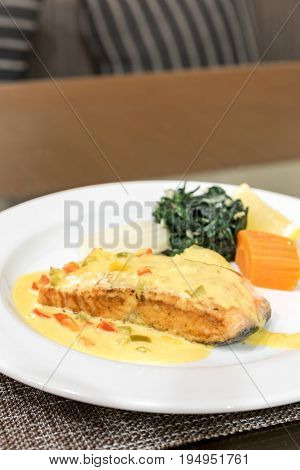 Frilled Salmon Steak with spinach and mustard sauce