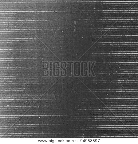 Abstract grunge dark photocopy texture background with light horizontal lines