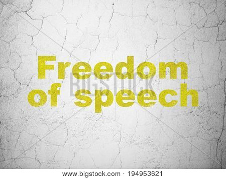 Politics concept: Yellow Freedom Of Speech on textured concrete wall background