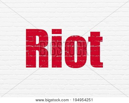 Politics concept: Painted red text Riot on White Brick wall background