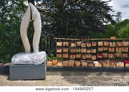 Sintra Portugal - June 6 2017: Sale of souvenirs handbags of cork on the streets of Sintra. Products from the cork tree is one of the most popular souvenirs in Portugal