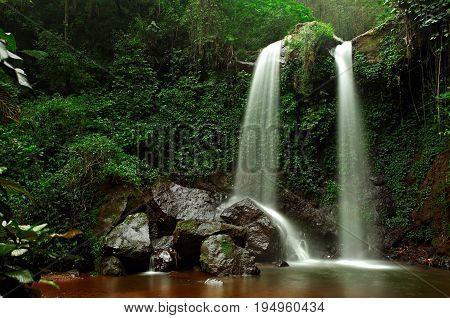 Grenjengan Kembar waterfall is located at Magelang Regency, Central Java Province, Indonesia.