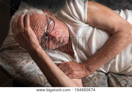 Old Man Lying In Bed