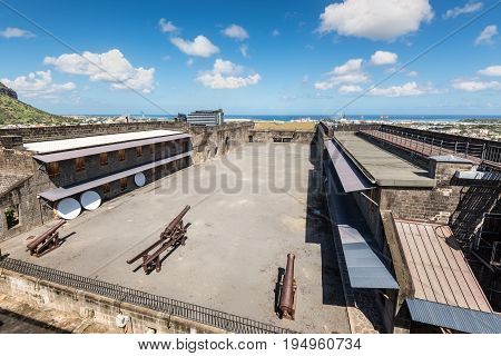 Port Louis Mauritius - December 25 2015: Fort Adelaide overlooking the city of Port Louis Mauritius capital city. The fortress dates back from the French colonial time.