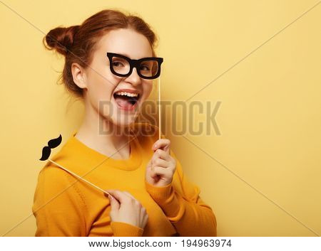 lifestyle and people concept: Happy girl  wearing fake mustaches
