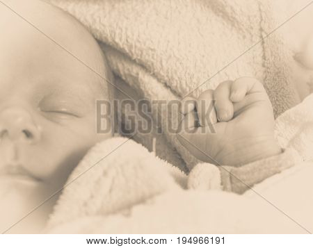 Infant care beauty of childhood concept. Little newborn baby sleeping calmly in bed surrounded with blankets