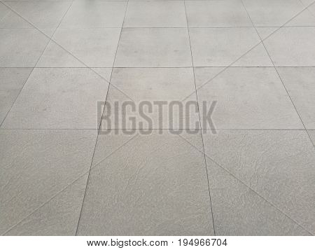 White floor pathway paved with tiles; perspective view; ground for sidewalk, pavers. For background and texture.