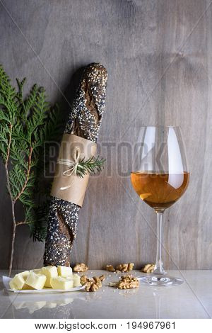 Bread And Wine Served With Walnuts On A Countertop. Restaurant Menu