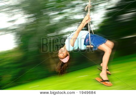 Young Girl Swinging Fast While Lying On Her Back