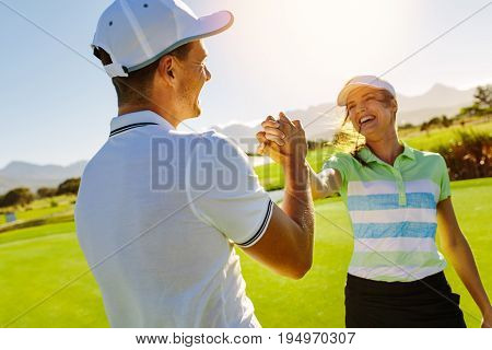 Golfers Shaking Hands At Golf Course