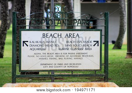 Honolulu Hawaii USA - May 28 2016: Kapiolani Park Sign - the park was given to the people of Hawaii from King Kalakaua in 1887 who named the park after his wife Queen Kapiolani.
