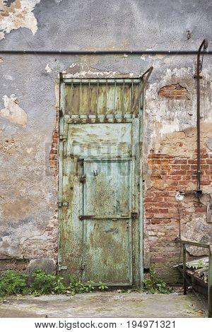 grunge metal door, cracked brick wall background
