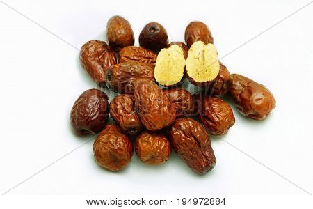 Red jujube (dried) on white background.Herbal fruit and good for health; using in traditional Chinese medicine.