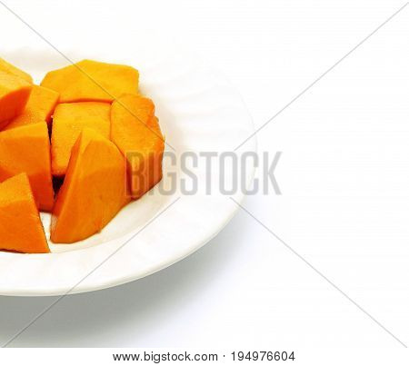 Cut papaya on plate and white background - Right copy space for add text. Deliciously sweet high fibre fruit; rich sources of antioxidant nutrients (carotenes, vitamins, folate, minerals, etc.).