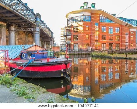 Houseboat on the channel of the Castlefield, an inner city conservation area, Manchester, England, United Kingdom