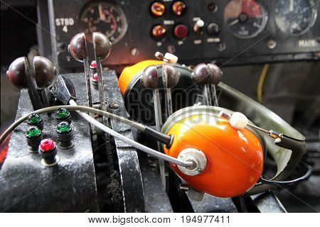 Throttle Control, Headphones And Instruments Of A Vintage Disused Cross Channel Hovercraft