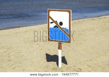 Swim ban sign on the beach Toned